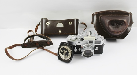 A LEICA M3 35mm FILM CAMERA, with Leitz Wetzlar lens and light meter, camera bears no. 1071700, in leather case