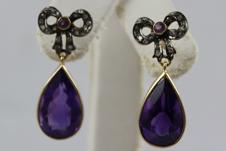 A PAIR OF AMETHYST AND DIAMOND DROP EARRINGS, having diamond set bow with central small circular amethyst, above pear shaped amethyst drop, stamped 585