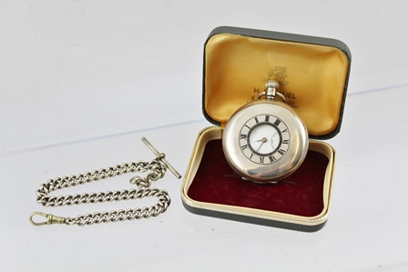 J.W. BENSON OF LONDON A SILVER CASED HALF-HUNTER POCKET WATCH, having white enamel dial with Roman numerals and secondary dial, the case by Dennison & Co. (Aaron Lufkin Dennison) Birmingham 1932, together with a plated WATCH CHAIN