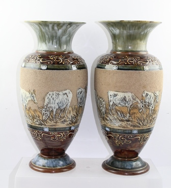 A PAIR OF LATE 19TH CENTURY DOULTON LAMBETH VASES of baluster form, decorated with cattle by Hannah Barlow, with blue green mottled glaze, impressed and incised factory marks to base, 35.5cm high