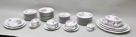 AN EXTENSIVE 20TH CENTURY LIMOGES PORCELAIN DINNER SERVICE decorated in pink floral swags, comprising serving platters, tureens, sauce boats and numerous sized plates and bowls, produced for and retailed exclusively through Bishops of Birmingham