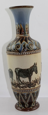 A LATE VICTORIAN DOULTON LAMBETH STONEWARE VASE by Hannah Barlow, the elongated baluster form modelled with a deep band of donkeys, stamped and incised factory marks to base, 32cm high
