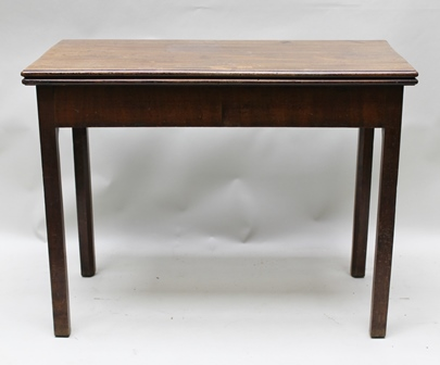 A 19TH CENTURY MAHOGANY FOLDOVER TEA TABLE fitted frieze end drawer, raised on squared supports, 94cm wide