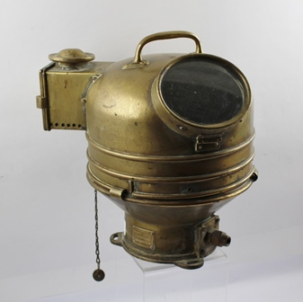 A MARINE BRASS BINNACLE MOUNTED COMPASS, bears label Patt 0919 - Compass No. 2030KS, the cover with spirit light, and top handle, overall height, 30cm