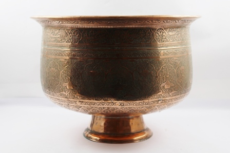 A LARGE PERSIAN COPPER BOWL having chased stylised floral decoration, raised on a plain domed foot rim, 42cm diameter