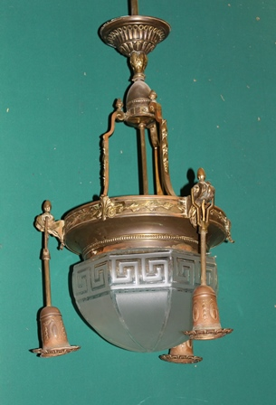 A DECORATIVE CONTINENTAL BRASS HANGING LAMP, with etched glass shade, having Greek key design, 104cm high