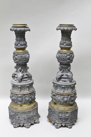 A PAIR OF LATE 19TH CENTURY ITALIAN CANDLESTICKS, of cast metal and brass construction with mask and acanthus leaf decoration, 44cm high