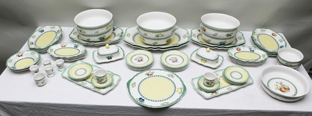 VILLEROY & BOCH AN EXTENSIVE FRENCH GARDEN FLEURENCE PATTERN DINNER SERVICE WITH COFFEE CUPS AND SAUCERS, comprising shaped plates of various sizes, serving platters, egg cups, pair of butter dishes with covers, large bowls etc., in all 64 pieces