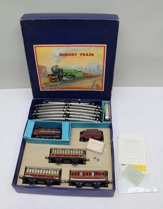A HORNBY 0 GAUGE TRAIN SET NO. 501 PASSENGER SET with tin plate clockwork 5600 Locomotive and Tender in LMS maroon livery, two passenger coaches and guards van, track original paperwork and box