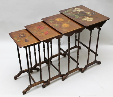 A QUARTETTO OF FRENCH OCCASIONAL TABLES, the lacquered tops each painted with a different floral design, raised on slender turned supports with scroll feet, circa 1900, largest top 55cm x 40cm