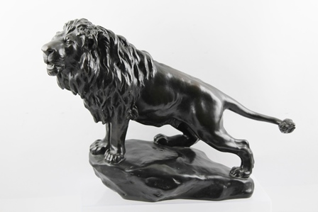 GYORGY VASTAGH (1834-1922) A FULL MANED BRONZE LION, standing on a rock effect base, bears signature, 32cm high