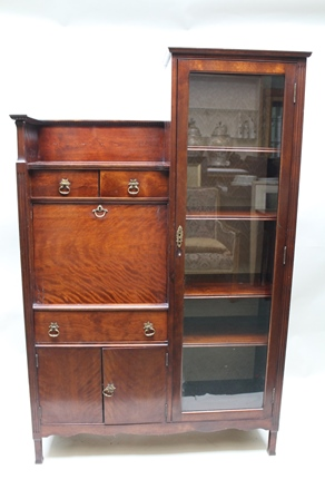 AN EDWARDIAN MAHOGANY COMBINATION BUREAU/DISPLAY CABINET with gallery section, drawers and cupboards, with brass handles, on squared supports, 161cm high x 104cm wide