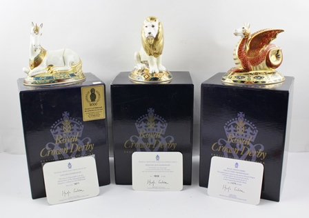 THREE ROYAL CROWN DERBY PAPERWEIGHTS, part of the Heraldic Collection, includes the Lion, Wyvern and Unicorn, limited editions of 2,000, each with their certificates and original boxes