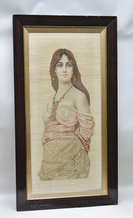 A LATE 19TH CENTURY GROS AND PETIT POINT NEEDLEWORK PANEL depicting a Middle Eastern slave girl, bound, clothed and wearing a turquoise bead decorated necklace, 98cm x 45cm, in painted wood frame