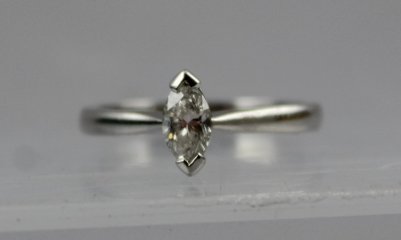 A LADYS SOLITAIRE RING, having marquise cut stone, the platinum shank stamped 950, size L