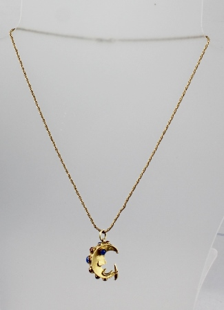 AN 18CT GOLD STYLISED CRESCENT MOON PENDANT, set with various cabochon stones on a 9ct gold chain