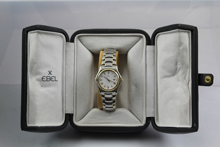 AN EBEL UNISEX STAINLESS STEEL AND GOLD WATCH, having calendar aperture with Roam enumerated white dial and 18ct gold bezel, on bracelet strap, in original leather presentation box