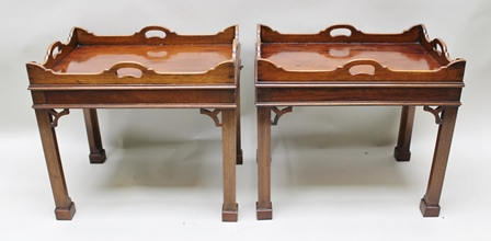 A PAIR OF MAHOGANY GEORGIAN DESIGN GALLERY TOP OCCASIONAL TABLES, with fitted candle slides, on squared supports with fret cut brackets, 39cm x 57cm