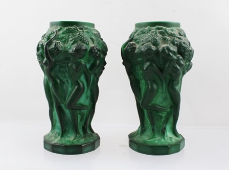 A PAIR OF HEINRIC HOFFMAN MOULDED INGRID MALACHITE GLASS VASES, designed for Curt Schlevogt, Gallonz, relief decoration in the round of cavorting naked young women, amidst foliage, 12.5cm high