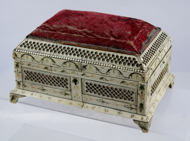 AN EARLY 19TH CENTURY FRENCH PRISONER OF WAR WORK BOX, the pine box overlaid in worked bone with fabric upholstered cover, raised on bracket feet, 22cm wide (see museum paper report inside)