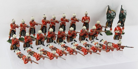BRITAINS, HIGHLAND SQUARE ASSORTED PAINTED CAST LEAD SOLDIERS,  red tunics and kilts, comprising riflemen, officers with binoculars and two pipers, 29 pieces