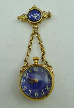 A 20TH CENTURY YELLOW METAL AND BLUE ENAMEL FOB WATCH, suspended on chains from a brooch mount, set blue guilloche enamel disc with urn and bird decoration, matching the decoration to the back of the watch case, diameter of watch 2.2cm, overall 7.5cm long