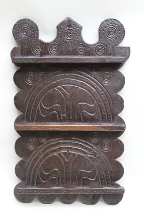 A PART 18TH CENTURY SPOON RACK, having carved initialled and shaped plank back over three pierced shelves, 46cm high
