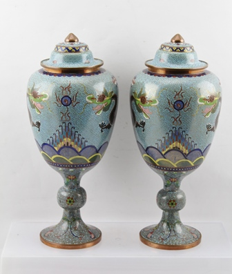 A PAIR OF 20TH CENTURY CHINESE CLOISONNE LIDDED VASES, raised on knopped stems with circular platform bases, pale blue ground with five-toed dragons chasing a flaming pearl, 32cm high