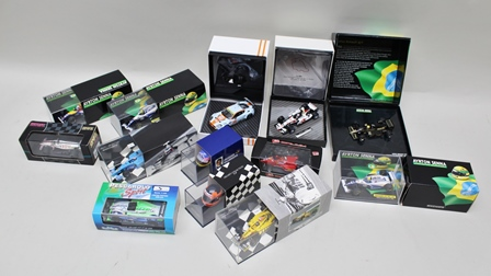 A COLLECTION OF MAINLY LIMITED EDITION FORMULA 1 DIE-CAST MODEL VEHICLES including; Aston Martin Racing DBR9, Ayrton Senna 3 models, Honda Racing Team Jenson Button, 1st win, Damon Hill, 2 Giles Villeneuve HELMETS and four others