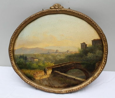 E ALTRUI Florence in the foreground a traveller and a stone bridge, the city lies in the distance, Oil painting on board, signed and dated 1882, 22 x 26cm, oval, in ornate gilt frame