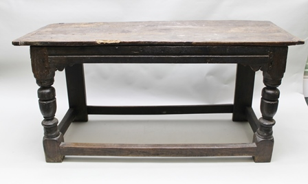 A PART 17TH CENTURY OAK SIDE OR SERVING TABLE, having three plank cleated top above channel-moulded friezes, raised on heavy baluster turned front legs, rectangular section back legs, 162cm x 62cm