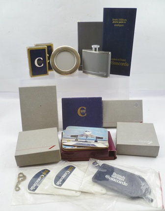 A COLLECTION OF CONCORDE MEMORABILIA, to include three silver photograph frames, a pair of silver decanter labels Vodka and Sherry, spirit flask, coasters, three packs of boxed playing cards, four diaries and three luggage labels