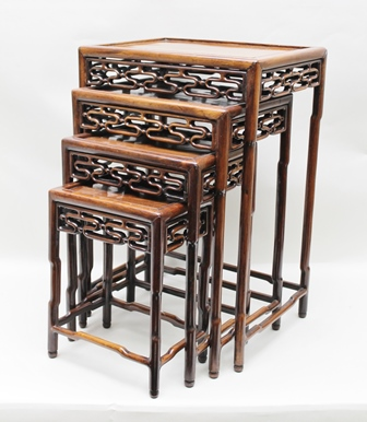 A QUARTETTO OF PADOUK WOOD EASTERN GRADUATED OCCASIONAL TABLES, largest 50cm x 36cm