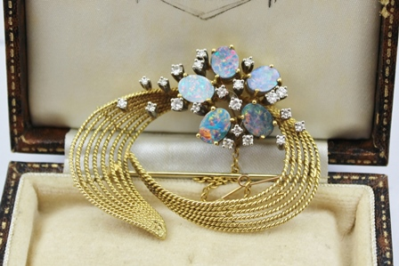 AN 18CT GOLD BROOCH having rope twist frame inset with diamonds and opals, 5cm x 4.5cm, fitted safety chain, boxed