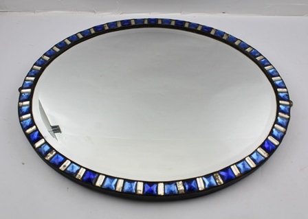A 19TH CENTURY OVAL FRAMED WALL MIRROR, the frame of alternate blue and clear mirror glass tiles, inset bevel plate, possibly Irish, mirror size 36.5cm x 45.5cm