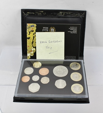 THE ROYAL MINT THE 2009 UK PROOF COIN SET containing 12 coins, including the Anniversary Kew Gardens 50p, housed in leather case with booklet/certificate