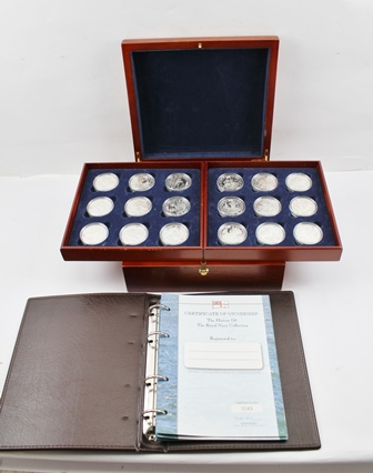 THE ROYAL MINT THE HISTORY OF THE ROYAL NAVY COLLECTION 2003-2005 A set of eighteen £5 silver proof coins, each encapsulated and housed in two lift-out trays within a wooden hinged case, together with certificates and binder