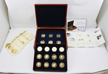THE ROYAL MINT THE GOLDEN STEAM AGE COLLECTION A set of eighteen sterling silver £5 coins 22ct gold plated, dated 2006, each encapsulated and housed in two lift-out trays within a hinged box, with certificates and other literature