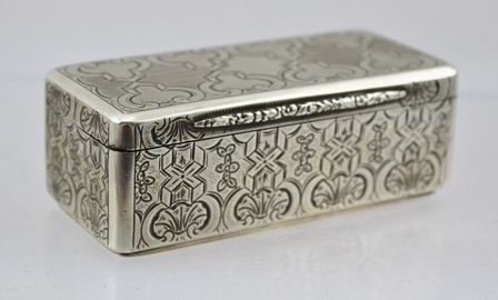 A MID 19TH CENTURY AUSTRIAN EMPIRE SILVER SNUFF BOX, engraved and engine turned decoration, gilded interior, marked for Prague 1857, maker IHK 9cm wide, weight 109g