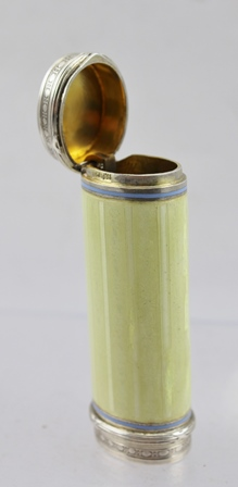 LOUIS KUPPENHEIM OF PFORZHEIM (1891-1982) A GERMAN SILVER AND ENAMEL CHEROOT CASE of cylindrical form, the  primrose yellow guilloche enamel body with hinged cover. The base with bound reed borders, gilded interior. Bears marks including makers and.900, 8.25cm long