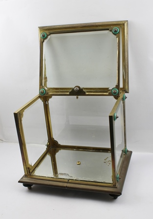 A TAHAN 19TH CENTURY CASKET, with bronze frame and glazed bevel plate sides with mirror base, inscribed Tahan Fr de lEmpereur, having malachite roundel decoration, 30cm high x 35cm wide