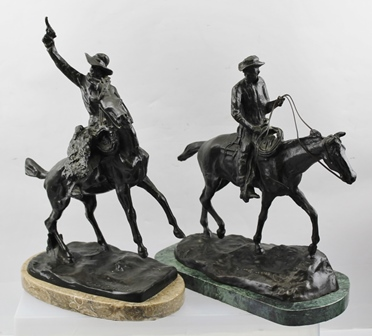AFTER CHARLES MARION RUSSELL (1864-1926) A PAIR OF BRONZES modelled as Cowboys on horseback, raised on polished marble bases, 28cm high