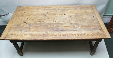 A SUBSTANTIAL 18TH CENTURY PITCH PINE KITCHEN/DINING TABLE having planked top, raised on deep plain frieze fitted deep end drawer, with turned knob handle, raised on turned column supports with plain stretchers, 183cm x 98cm