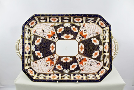A ROYAL CROWN DERBY TRAY decorated in the Imari palette, of rectangular form with canted corners and extended handles - 2451 pattern, 48cm x 31.5cm