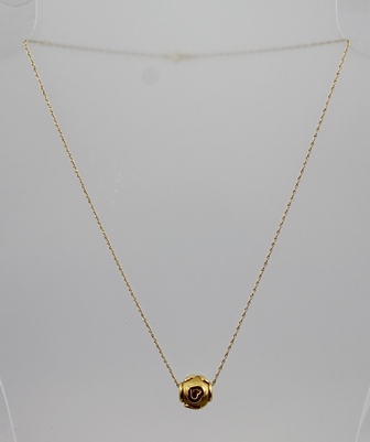AN UNUSUAL 18CT GOLD BALL PENDANT, decorated with raised heart shaped decoration on a brushed gold background, on an 18ct gold chain, both stamped 750