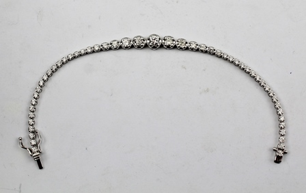 AN 18CT WHITE GOLD LADYS DIAMOND BRACELET, set with fifty-one graduated diamonds, approximately 5ct., the bracelet stamped 750