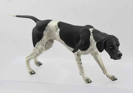 A 20TH CENTURY HUTSCHENREUTHER PORCELAIN POINTER MODEL, factory mark to pad, 27.5cm long