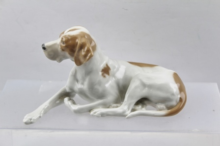 A ROYAL COPENHAGEN PORCELAIN MODEL OF A RECUMBENT POINTER, c.1970, modelled by Lauritz Jensen, factory mark below includes reference no.1635, 23.5cm long