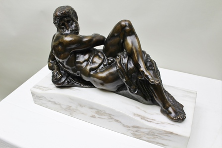 AFTER MICHAELANGELO Day A cast bronze figure as represented on the Tomb of Giuliano di Lorenzo de Medici, in the Cappella dei Principi, Florenze, inscribed F. Barbedienne Foundry, mounted upon a marble plinth base, 54cm wide, total height 35cm