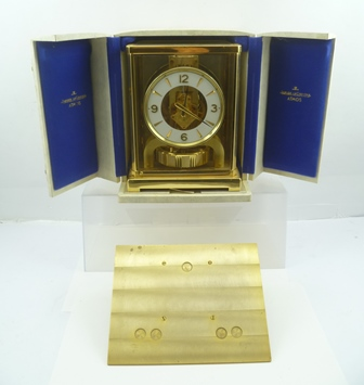 A JAEGER-LE-COULTRE ATMOS CLOCK, the dial with Arabic numerals at the quarters, 22cm high, in original case (also includes a brass wall bracket)